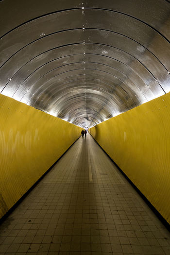 Man in illuminated tunnel