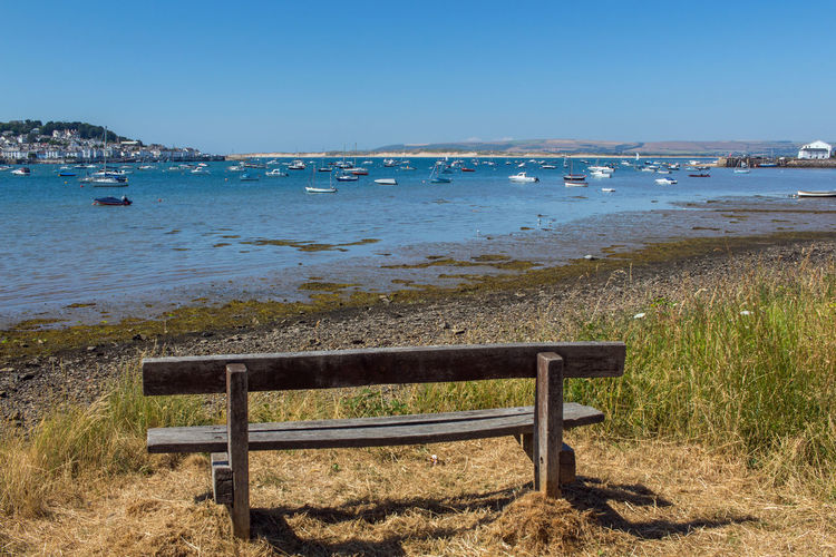 Devon UK Harbour View Instow Uk Yachts Appledore Architecture Beach Beauty In Nature Bench With A View Blue Clear Sky Day Grass Land Nature Nautical Vessel No People Outdoors Sailboat Scenics - Nature Sea Sky Tranquil Scene Tranquility Water