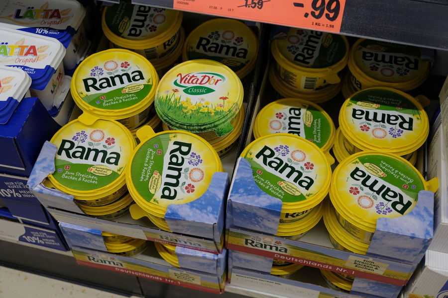 Berlin, Germany - August 25, 2017: Rama Margarine for sale. Rama (also called Blue Band) is a Unilever brand of margarines, cheese spread and vegetable fat spreads. It is widely available in Germany Cooking Cuisine Margarine Substitute Supermarket Baking Butter Close-up Fatty Flavoring Flavouring Food For Sale Indoors  Ingredient Kitchen Large Group Of Objects Margarina Market No People Recipe Retail  Shop Store Unhealthy Eating
