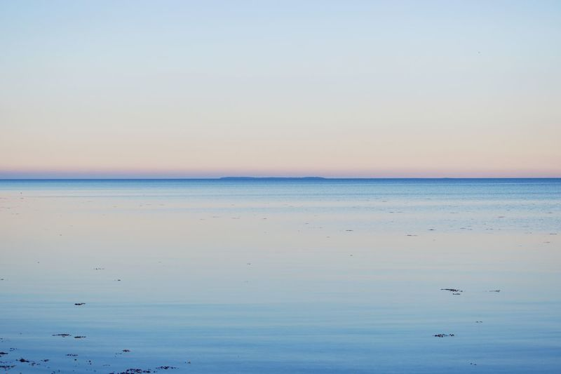 Beauty In Nature Blue Calm Clear Sky Horizon Over Water Idyllic In The Distance Island Nature Outdoors Scenics Sea Seascape Sky Sunset Tranquil Scene Tranquility Water Waterfront 50/50 Denmark Scandinavia Landscapes With WhiteWall Blue Wave