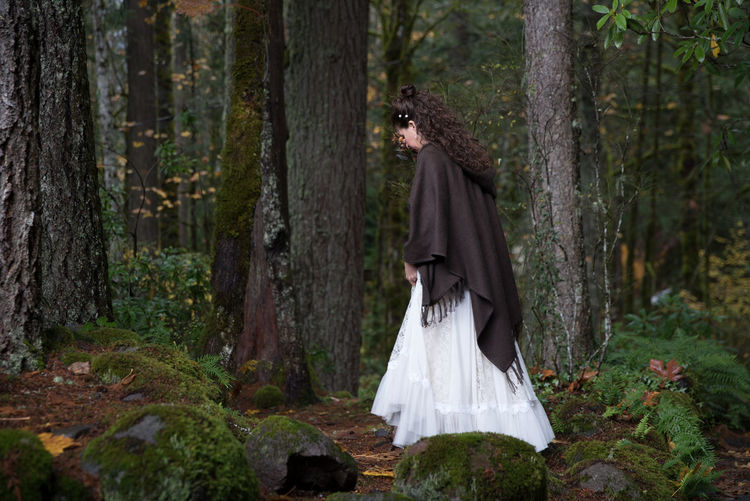 EyeEmNewHere Alone Green Nature Solace Trees White Dress Beautiful Woman Beauty Beauty In Nature Curly Hair Forest One Person Outdoors Peaceful Shawl Solitude Tree Trunk Walking Wild Woman In Forest WoodLand EyeEmNewHere