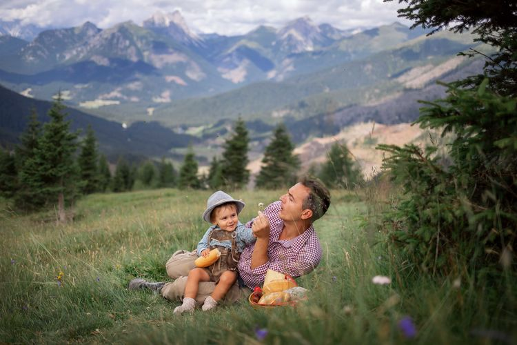 Mature man with son on mountain