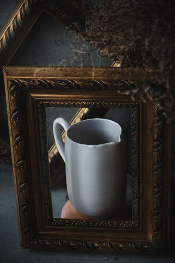 Ceramic white milk jar in picture frames. Painting-look composed shots. Ode to clay. No People Still Life Close-up Ceramic Art Ceramics Tea Cup Teapot Decanter Jar Picture Frame Paintings Art And Craft Kitchen Utensil Pottery Dish Handmade Hand Made Wall Art Rembrandt Light Crafted Beauty darkness and light Low Light Low Key High Angle View