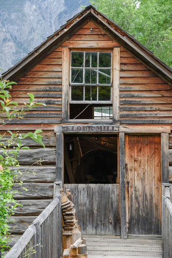 Keremeos, British Columbia/Canada - June 3, 2017: the old flour mill building at The Grist Mill and Gardens Keremeos, an important historic site dating to 1877. 1800's Building 1877 Afternoon British Columbia, Canada The Grist Mill And Gardens Keremeos Travel Wood Editorial  Flour Mill Grist Mill Heritage Site Historic Building Historic Site June Keremeos Museum Old Outdoors Restored South Okanagan Spring Tourism Tours Vintage Wooden