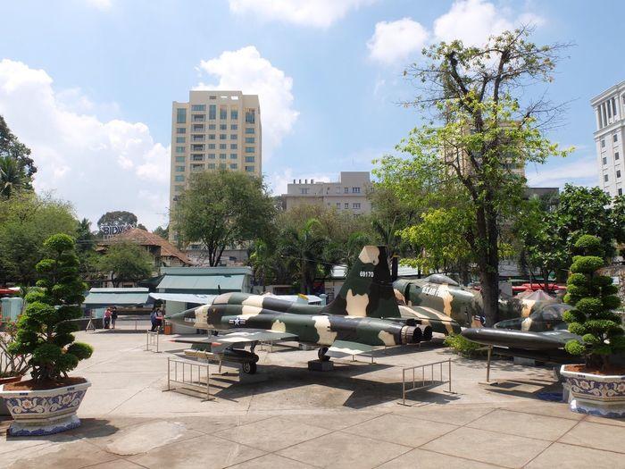 Group of people in park against buildings in city