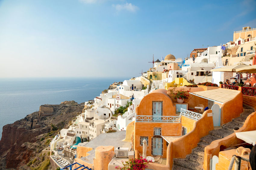 Greece Santorini Oia Thira Architecture Building Exterior Built Structure Building Water Sky Sea City Residential District Nature Travel Destinations Horizon Over Water Day Travel Horizon Town History The Past Crowded Community Outdoors Cityscape TOWNSCAPE
