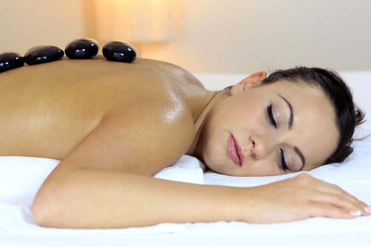 Young woman having lastone therapy