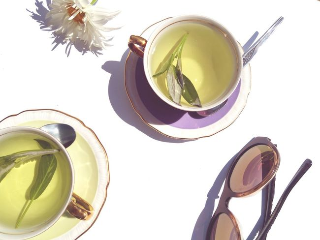 EyeEm Selects Tea - Hot Drink Food And Drink Still Life Drink High Angle View Porcelain Cup Healthy Eating Green Tea No People Studio Shot Indoors  Freshness Day Daylight Light And Shadows Salvia White Flower Chrysanthemum Margaret Flower White Table White Background Sunglasses Reflection Meetings