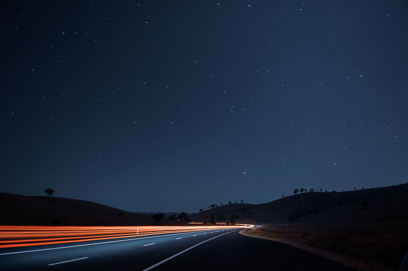 Ilford Night Road Sky Transportation Direction Star - Space The Way Forward Space No People Astronomy Nature Illuminated Scenics - Nature Star Beauty In Nature Light Trail Mountain Motion Long Exposure Star Field Diminishing Perspective Outdoors