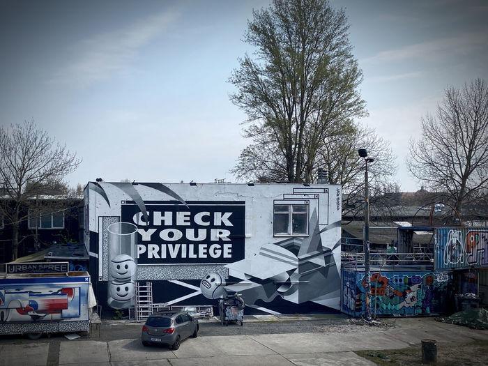 Graffiti on wall against sky