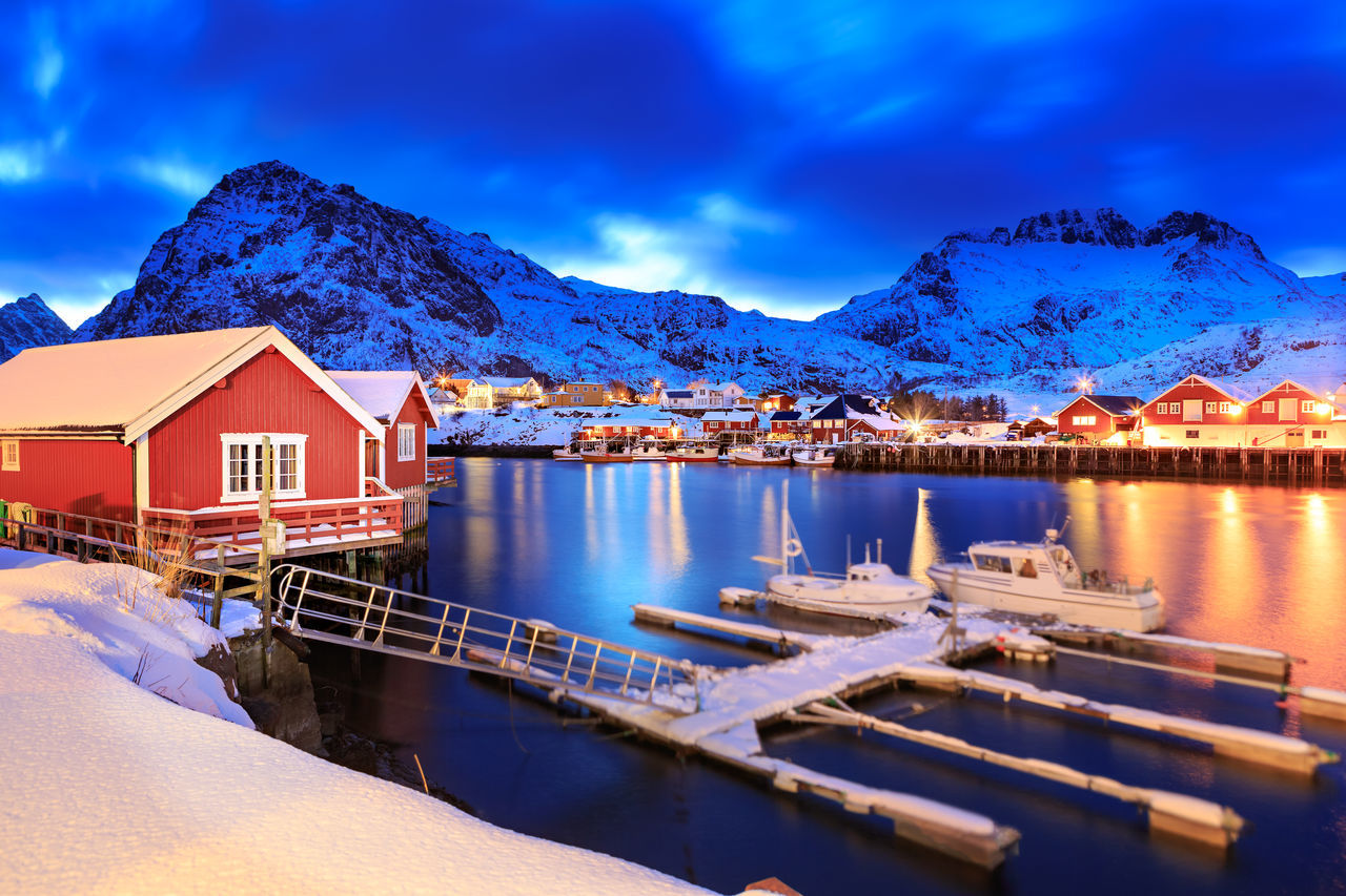 mountain, sky, architecture, built structure, house, building exterior, water, mountain range, scenics, no people, blue, cloud - sky, tranquility, outdoors, nature, beauty in nature, day, snow, moored