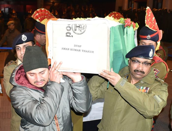 A wreath laying ceremony was held at District Police Lines Srinagar to pay homage to DySP Aman Thakur who was killed in an encounter with militants in Kulgam on Sunday. Kashmir Encounter Men Placard Togetherness Volunteer Senior Adult Text