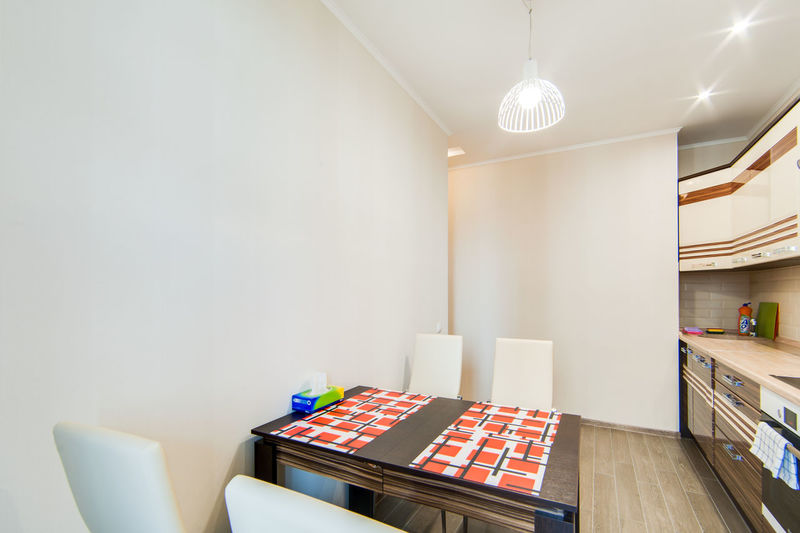 Indoors  Table Seat Furniture Absence Lighting Equipment No People Chair Home Interior Modern Wood - Material Illuminated Sofa Home Showcase Interior Multi Colored Copy Space Domestic Room Wall - Building Feature Ceiling Empty Luxury Electric Lamp