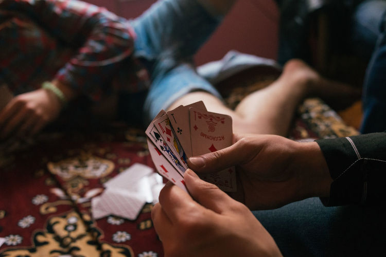 Friends Playing Cards At Home