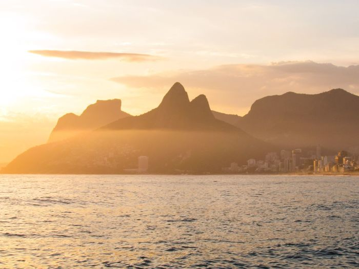 Ipanema Beach Rio De Janeiro Rio De Janeiro Eyeem Fotos Collection⛵ Mountain Scenics - Nature Beauty In Nature Sky Sunset Tranquil Scene Water Tranquility Environment Mountain Range Idyllic Travel No People Travel Destinations Nature Non-urban Scene Sea Landscape Land Outdoors
