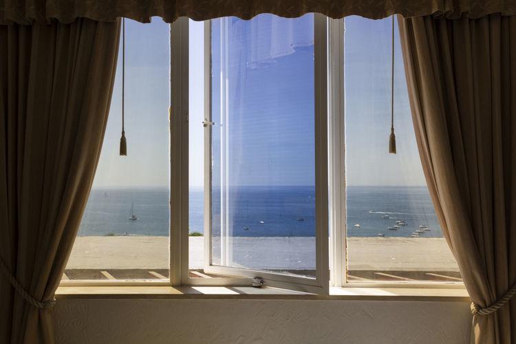 Sea seen through glass window