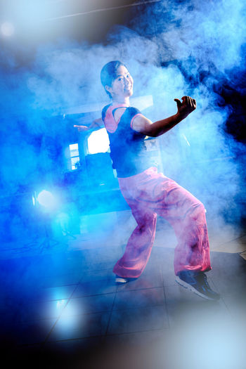 Full Length Of Woman Dancing Amidst Smoke