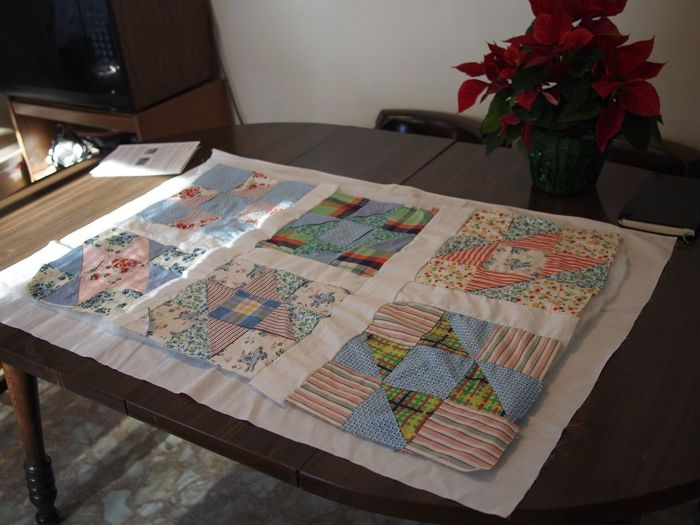 Poinsettia Christmas Decoration Crafts Quilting Kitchen Table Quilting Quilt Indoors  High Angle View Table Home Interior No People Plant Flower Pattern