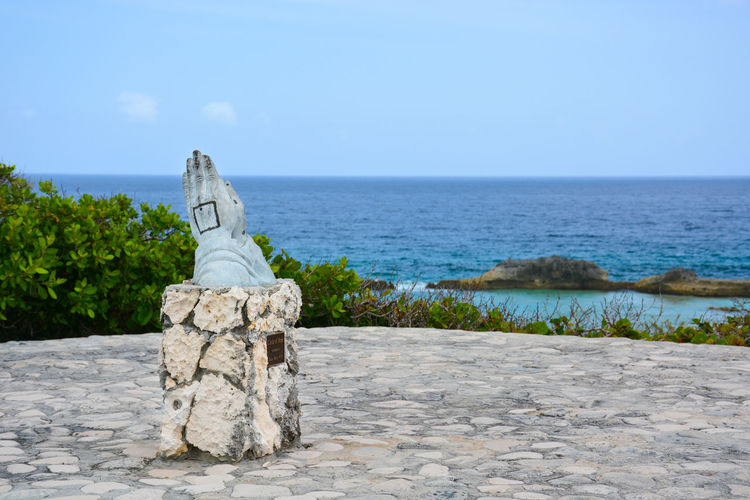 Circle of Life at Mudjin Harbour on Middle Caicos Middle Caicos Turks And Caicos Turks And Caicos Islands Turksandcaicos Ocean Pray Praying Praying Hands Scenics Beauty In Nature No People Day Nature Statue Clear Sky Horizon Over Water Outdoors Sky Sculpture Rock - Object Water Sea