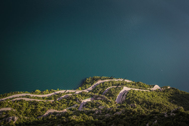 Look into the deep Gardasee Limone Sul Garda Aerial View Beauty In Nature Day Environment Green Color High Angle View Idyllic Island Italy Land Landscape Mountain Nature No People Outdoors Scenics - Nature Sea Tranquil Scene Tranquility Water The Great Outdoors - 2018 EyeEm Awards