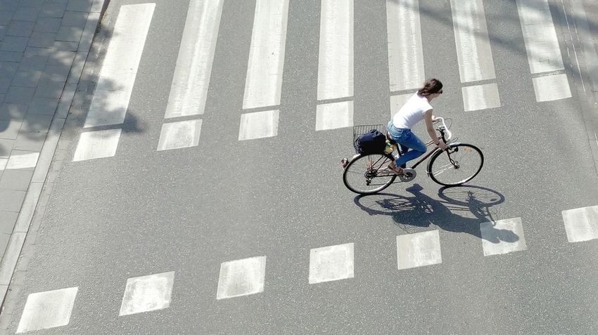 Bicycle Transportation City Riding Lifestyles Cycling One Person Sport Shadow Street Photography Real People