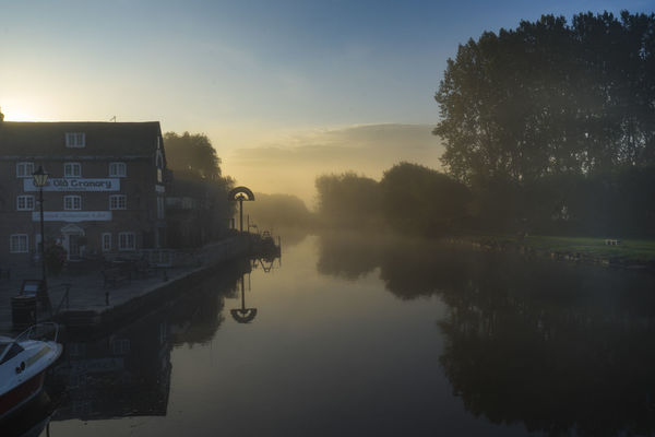 Mist morning on the River Frome, Wareham, Dorset, UK River Frome Water Reflections Architecture Beauty In Nature Building Exterior Built Structure Day Early Morning Mist Misty Morning Nature No People Outdoors Reflection River Tree Water Water Reflection