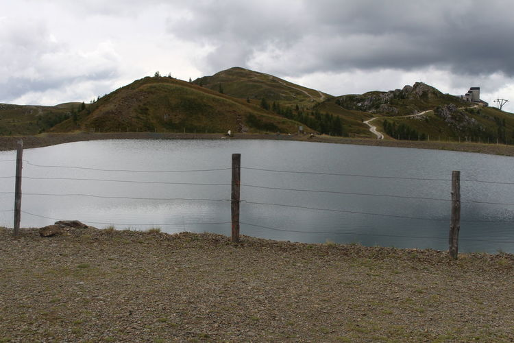 A volcanic lake Kaiserburgsee close to Bad Kleinkirchheim, a resort in Kaernten. Mountain Cloud - Sky Water Sky Fence Tranquility Nature Barrier Tranquil Scene Beauty In Nature Security Scenics - Nature Lake Day Outdoors