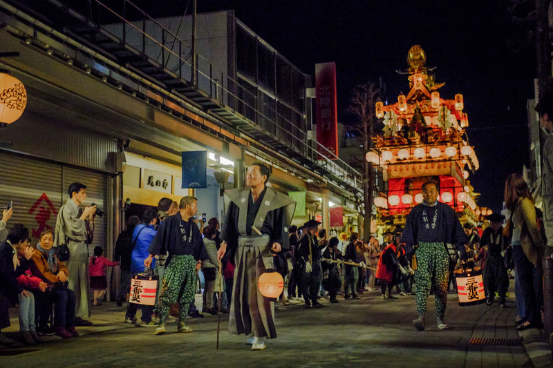 Built Structure City City Life Crowd Culture Cultures Illuminated Japan Japanese Culture Kagura Large Group Of People Leisure Activity Lifestyles Market Market Stall Matsuri Mixed Age Range Night Outdoors Samurai Temple - Building Tourism Travel Destinations