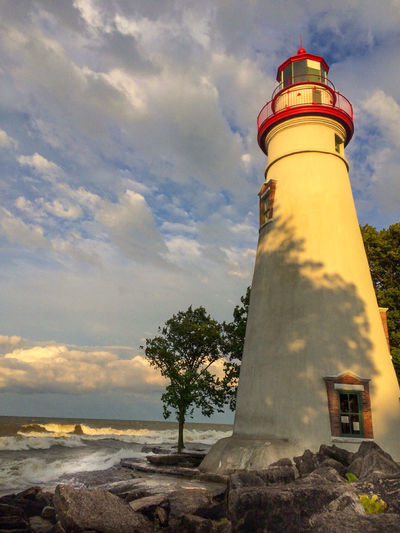 same picture as before, but edited more Cloud Lake Erie Marblehead Marblehead Lighthouse Marblehead, OH Lighthouse Architecture Built Structure Cloud - Sky Land Lighthouse Low Angle View Nature No People Outdoors Sea Sky Tree The Architect - 2018 EyeEm Awards The Great Outdoors - 2018 EyeEm Awards