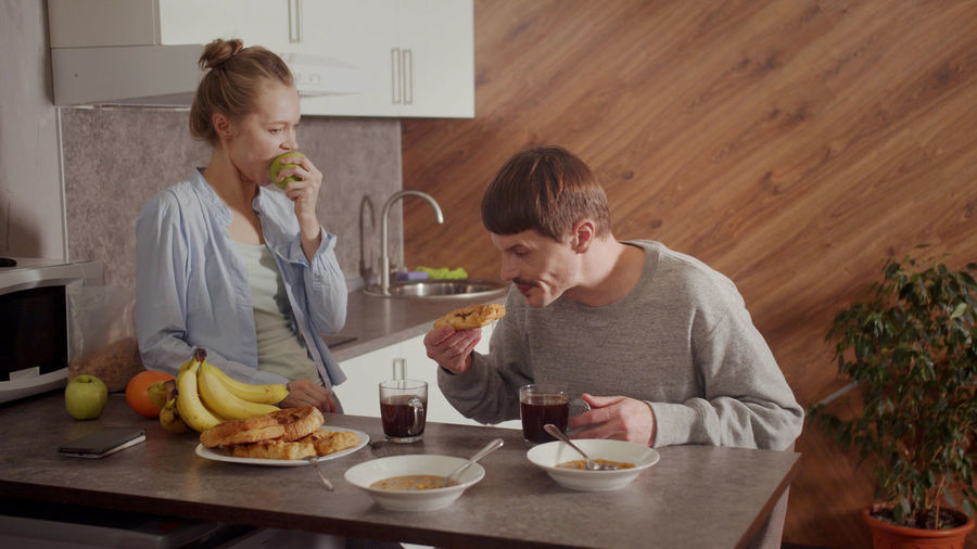 Wife and husband having discussion at kitchen