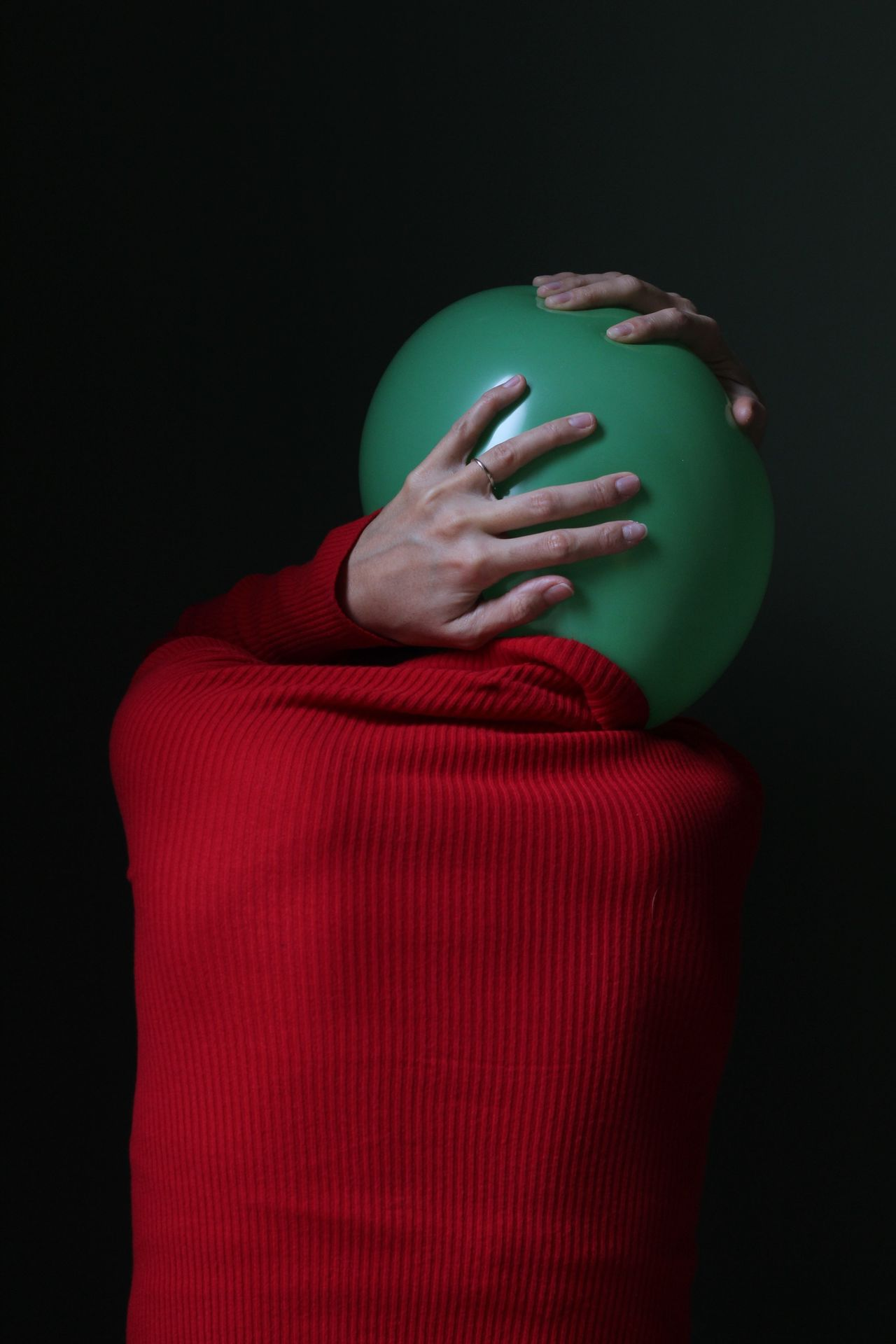 indoors, studio shot, red, one person, black background