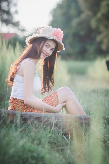 Plant Young Adult Young Women Real People Leisure Activity Beautiful Woman One Person Grass Beauty Land Women Lifestyles Field Long Hair Nature Teenager Portrait Three Quarter Length Outdoors Hairstyle Casual Clothing Hair Day