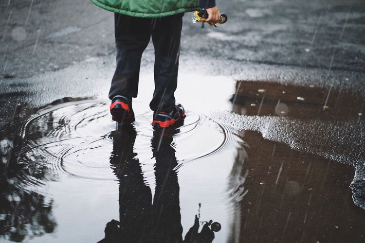 Rainy playground 🌧... Casual Clothing Experience Autumn Weather Weather Condition Urban Family Raining Rain Childhood Child Playground Playing Toy Silhouette Low Section Human Leg Body Part Street City Human Body Part One Person Wet Road Shoe Water Puddle Reflection Shadow Standing