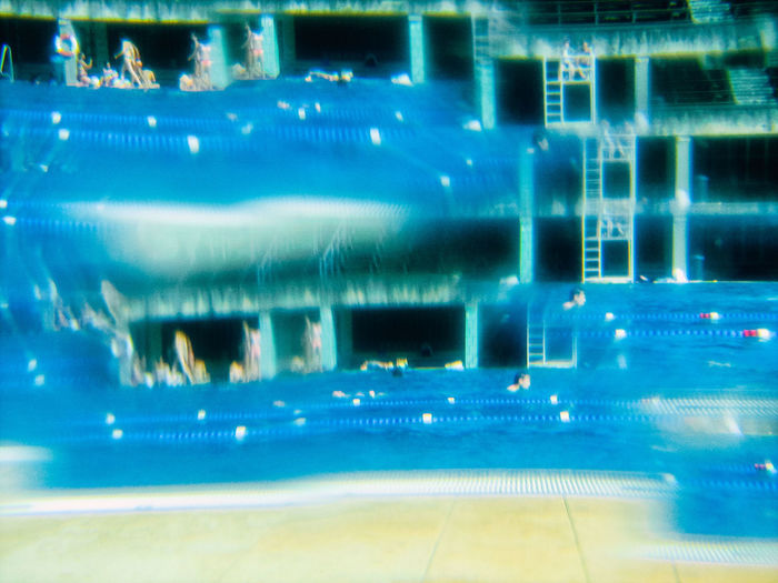 Abstract image of illuminated swimming pool in city