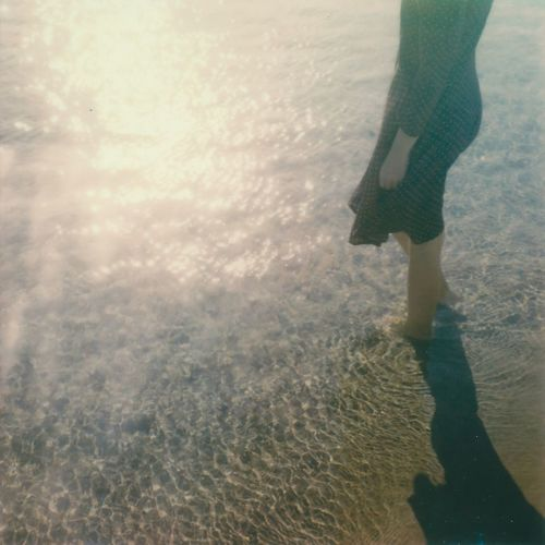 Film Photography Analogue Photography Polaroid Water Reflections Sea Low Section One Person Lifestyles Real People Human Body Part Human Leg Water Body Part Sunlight Women Standing Beach Outdoors Shadow