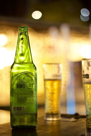 Alcohol Drink Bottle Refreshment Container Food And Drink Focus On Foreground Beer - Alcohol Table Glass - Material Indoors  Beer Bottle Beer No People Glass Close-up Drinking Glass Transparent Still Life Green Color Bar Counter