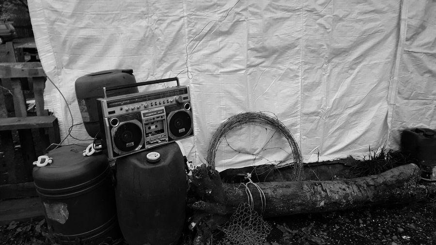 Old radio on can against tarpaulin