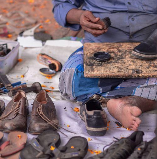 Low section of cobbler polishing shoe