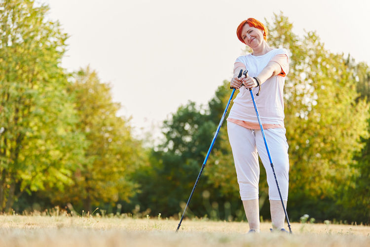 Woman Standing With Walking Canes At Park