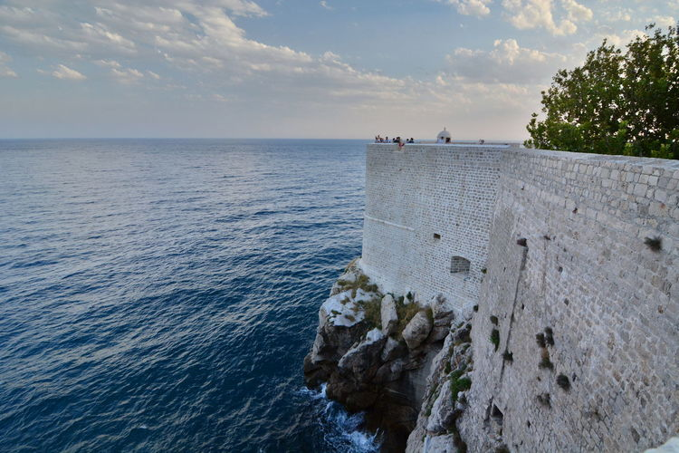 Old town walls. Dubrovnik. Croatia Architecture Croatia Dubrovnik, Croatia Historical Building Old Town UNESCO World Heritage Site Adriatic Coast Adriatic Sea Cloud - Sky Dalmatia Dubrovnik Europe Horizon Over Water Old Town Walls Outdoors Scenics Sea Travel Destinations Walls Water
