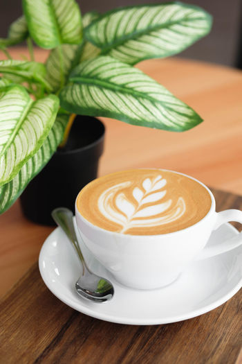 Coffee - Drink Coffee Coffee Cup Mug Cup Food And Drink Saucer Drink Frothy Drink Refreshment Hot Drink Cappuccino Crockery Still Life Froth Art Table Indoors  Leaf Latte Close-up No People Non-alcoholic Beverage Froth