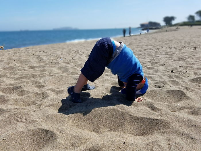 Toddlerlife Yoga Downwarddog Beachphotography Beach Day Nannylife Sflife Sanfrancisco Alcatraz In Sight Focus On Foreground Nofilter Toddlerproblems