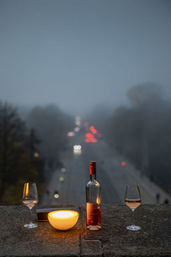 Glass of wine on table at dusk