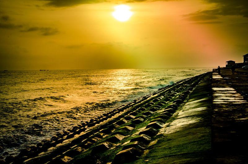 Beach Beauty In Nature Cloud - Sky Horizon Horizon Over Water Idyllic Incidental People Land Nature Orange Color Outdoors Scenics - Nature Sea Sky Sun Sunlight Sunset Tranquil Scene Tranquility Water