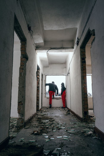 Marriage 2. Jumping Damaged Ruins Red Work Equipment Damaged Architecture Woman Man Couple Couple - Relationship One Man Only One Woman Only 2 People People Real People Full Length Architecture Built Structure Corridor Passageway Entrance Hall Building Settlement Bad Condition Deterioration Abandoned #NotYourCliche Love Letter