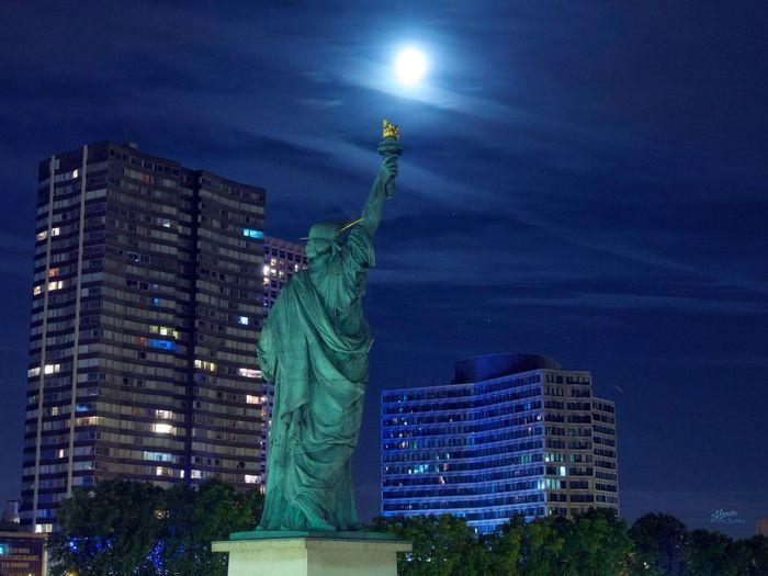Behind Liberty, no NYC but PARIS 🗽 Hello World Nightphotography Night Lights Paris Bridge Liberty Blue Moon City Photography Photooftheday Streetphotography Nofilter