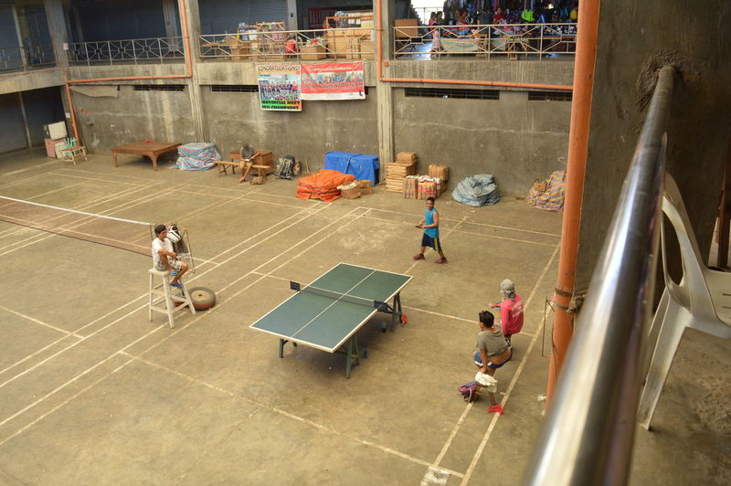 They were playing Table Tennis inside the Public Market Indoor Leisure Activity Lifestyles Market Men Playing Table Tennis Table Tennis
