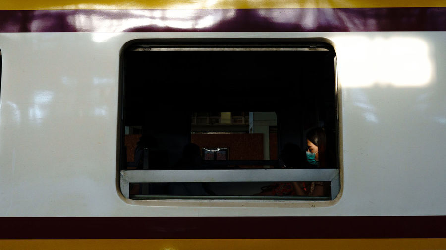 Reflection of train on window