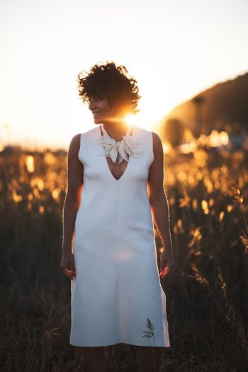 EyeEm Selects Sunset One Person Sky Women Nature Young Adult Sunlight Land Fashion Front View Adult Field Plant Standing Grass Casual Clothing Real People Young Women Leisure Activity Lifestyles