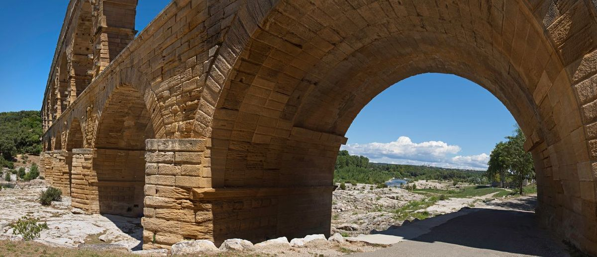 Pont-du-Gard Provence Pont Du Gard Water Supply Water Supply Pipe Aquaeduct History Historical Landmark Roman Architecture Sunlight Nature Arch Built Structure Sky Day History Clear Sky Travel Destinations Sunny